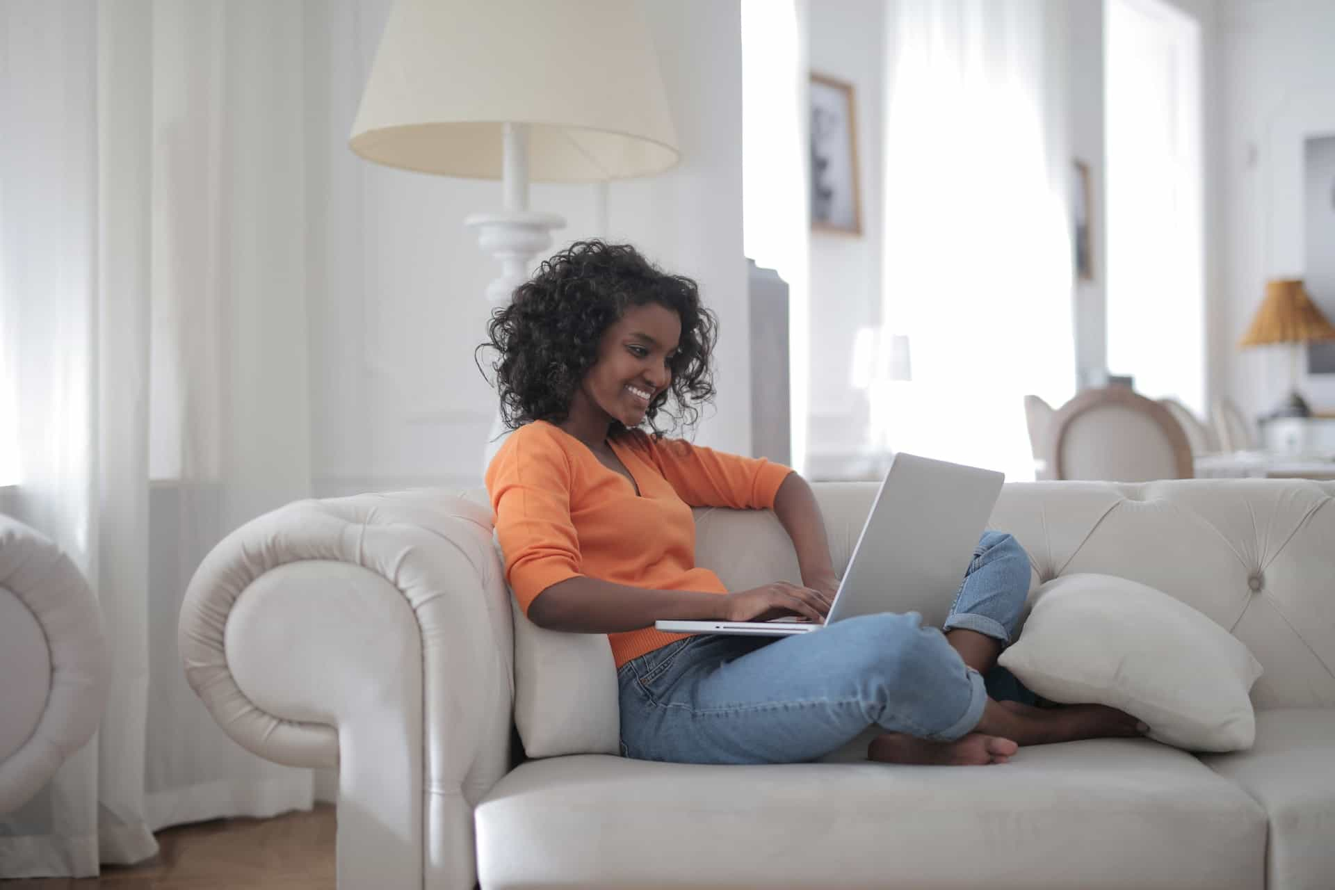 woman-sitting-on-white-couch-using-laptop-computer-3960127 (1)